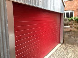 Alutech Small Rib insulated sectional garage door in Red RAL colour
