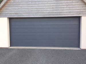 Carteck Medium Rib insulated sectional garage door in Anthracite Grey with cedar cladding above