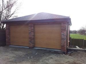 Hormann M rib sectional garage doors in Golden Oak