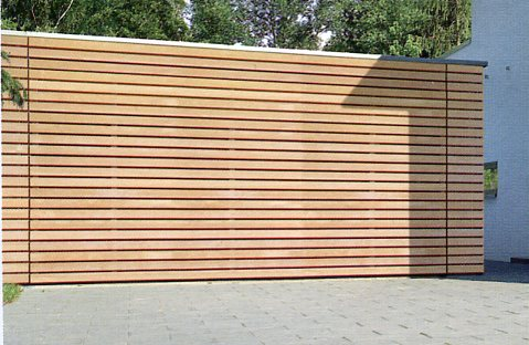 Picture ALR sectional garage door with  on-site cladding