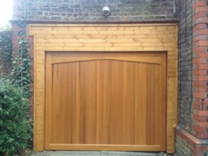 Pictures showing an old broken garage door and the replacement of a Woodrite Buckingham