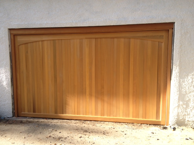 Double garage doors up over sectional wood roller for Garage doors uk