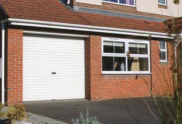 Electric roller garage doors prices electric roller doors for Rear garage door