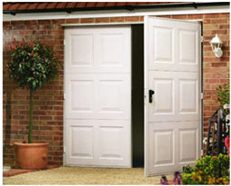 Picture of White Garador  Steel Georgian design side hinged garage doors on pre-fitted steel frame