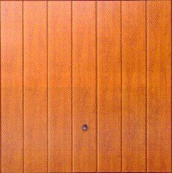 Picture of Steel Vertical-Rib Hormann garage door in Golden Oak Decograin finish