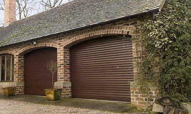 Picture of Pair of Aluroll insulated roller garage doors in Rosewood foil laminate