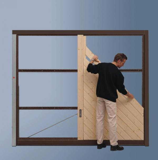 Photo of a man putting planks on an OFI door