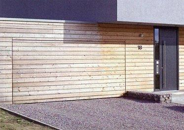 Photo of an onsite cladding of Hormann OFI up and over garage door.