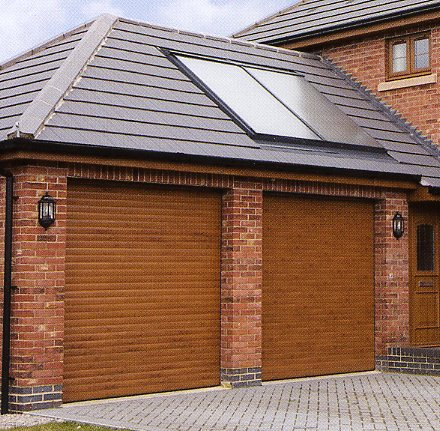 Picture of a pair of Aluroll insulated roller garage Doors in Golden Oak