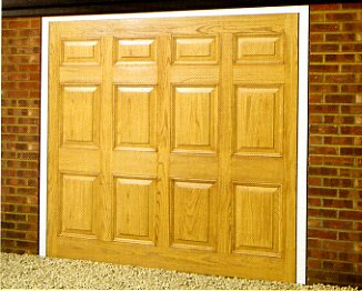 Picture of Wessex Canterbury GRP garage door in light Oak wood effect
