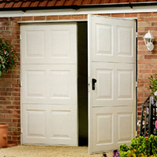 Side hinged garage doors prices steel timber grp for Garage side door and frame