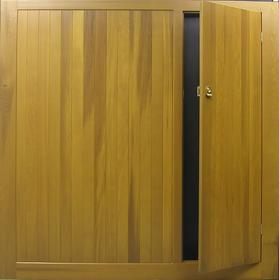 Cedar Door Bakewell up and over door with in built wicket door