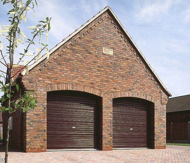 Picture of Steel-line roller garage doors in Mahogany wood laminate finish