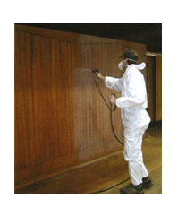 Picture showing method of spray finishing a Cedar garage door