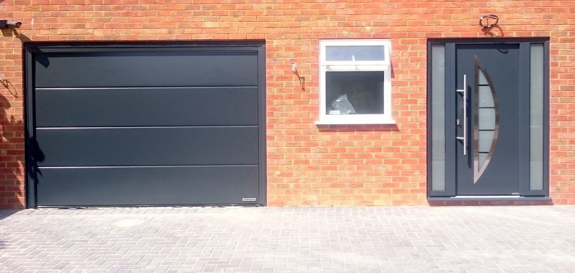 Hormann LPU42 insulated sectional and Thermo46 TPS 900 front entrance door and side elements all in Anthracite Grey