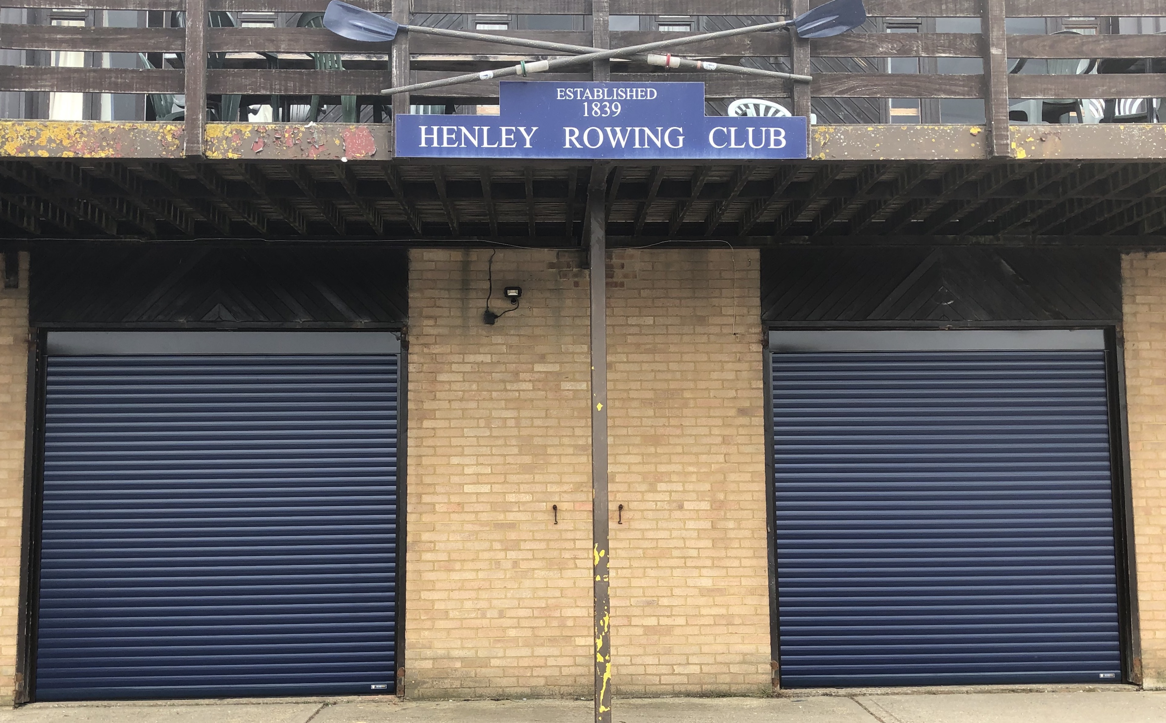 Aluroll insulated roller shutters in Steel Blue installed on a Henley Rowing Club