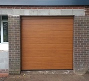 Hormann LPU insulated sectional garage door in Golden Oak