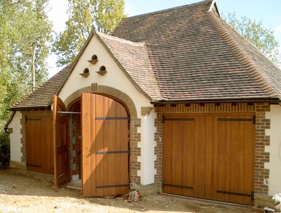 Three pairs of cedar wood barn style side hinged garage doors