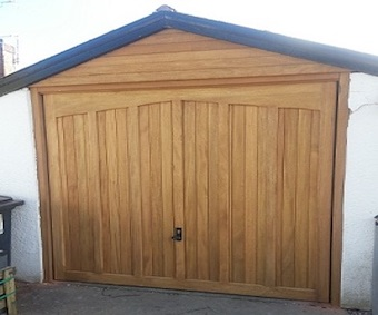 Woodrite Idigbo up and over garage door installed by us