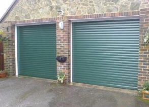 Two insulated automatic roller garage doors in Green colour