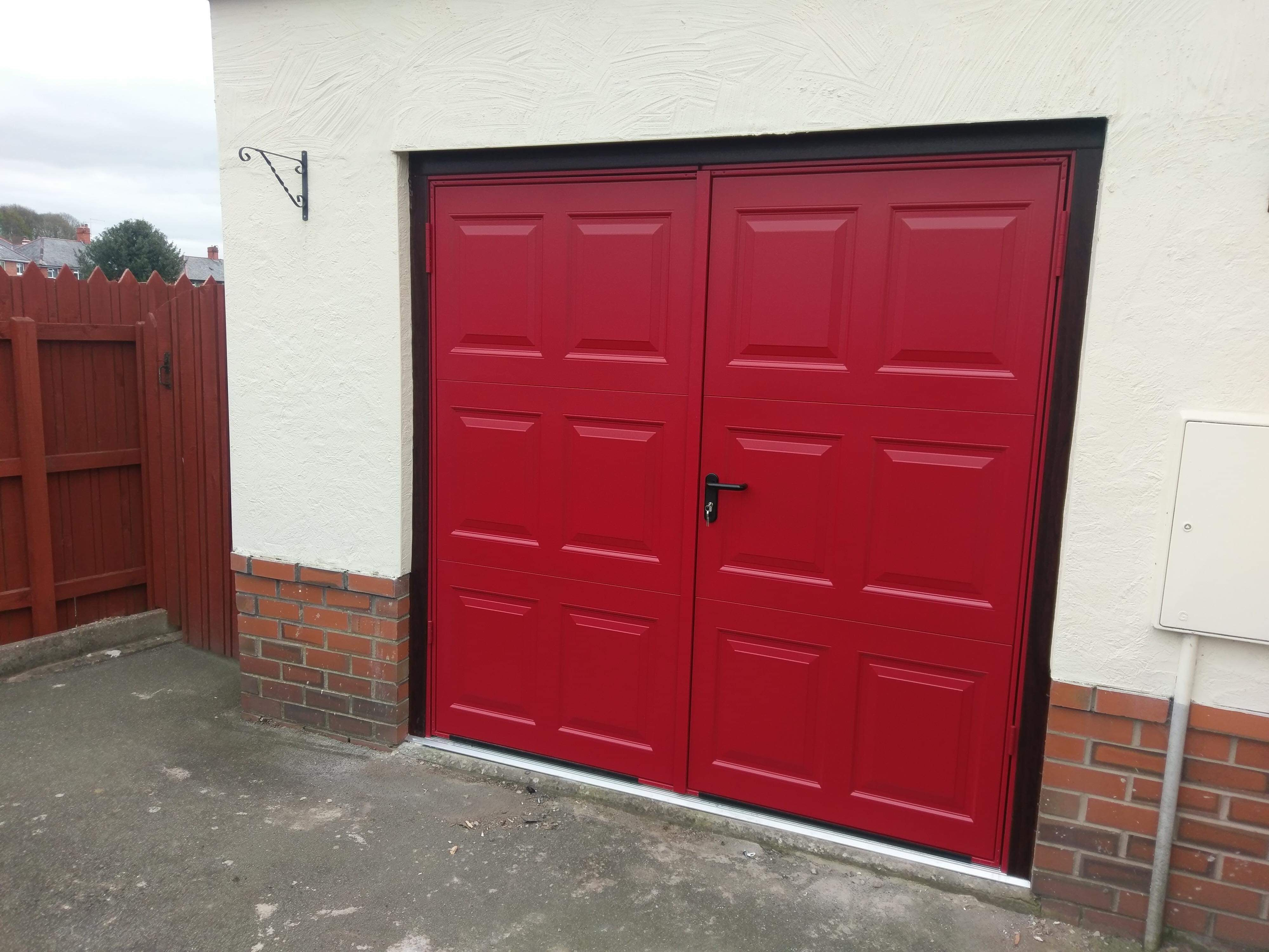 Georgian steel side hinged garage door in a red RAL colour