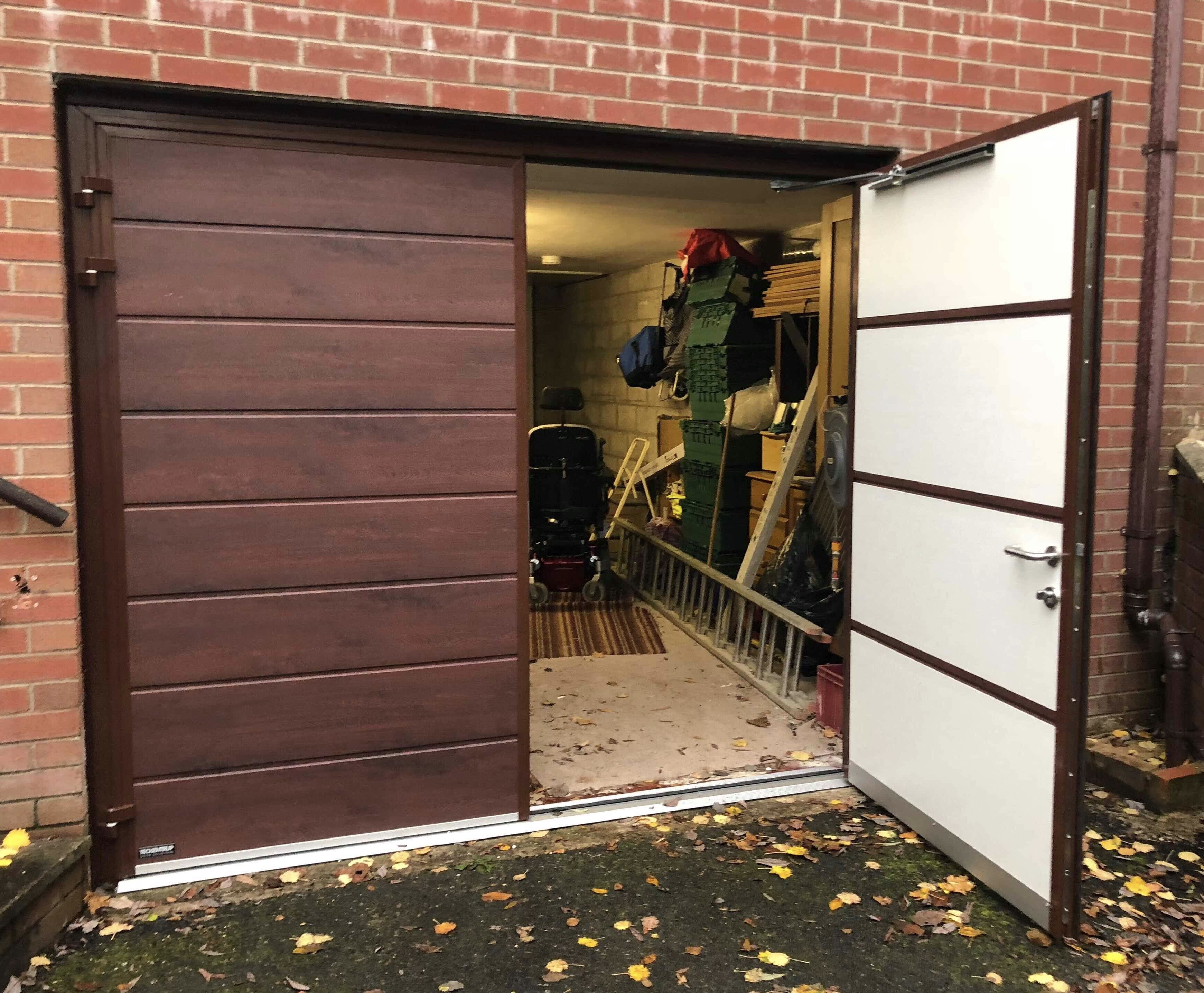Insulated steel side hinged garage door in rosewood finish