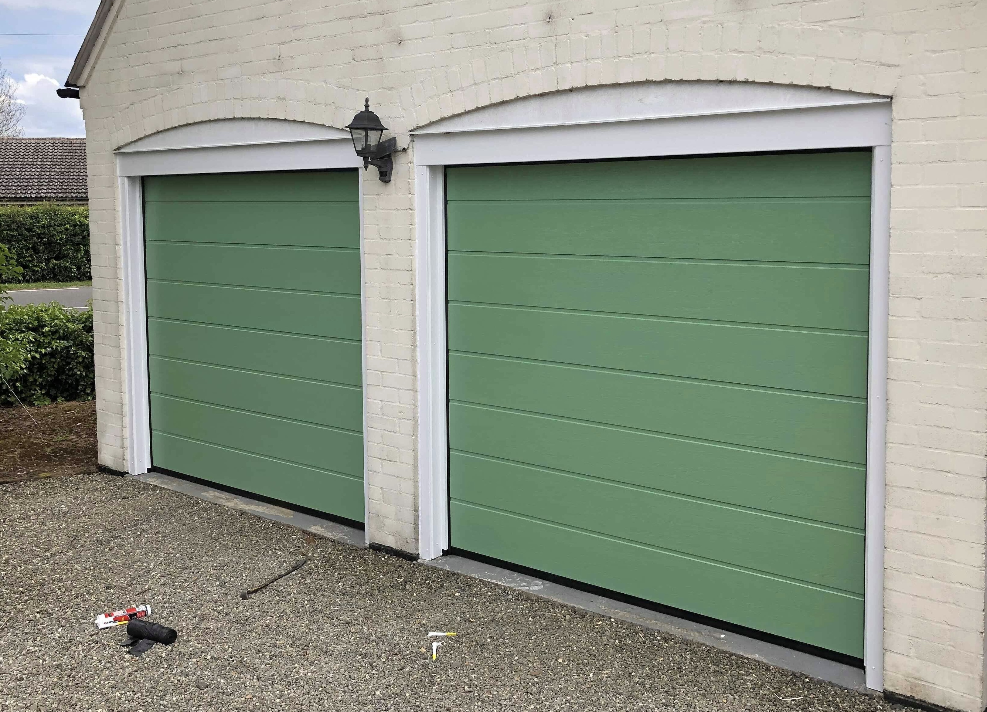 Two sectional garage doors in Chatwell Green RAL colour