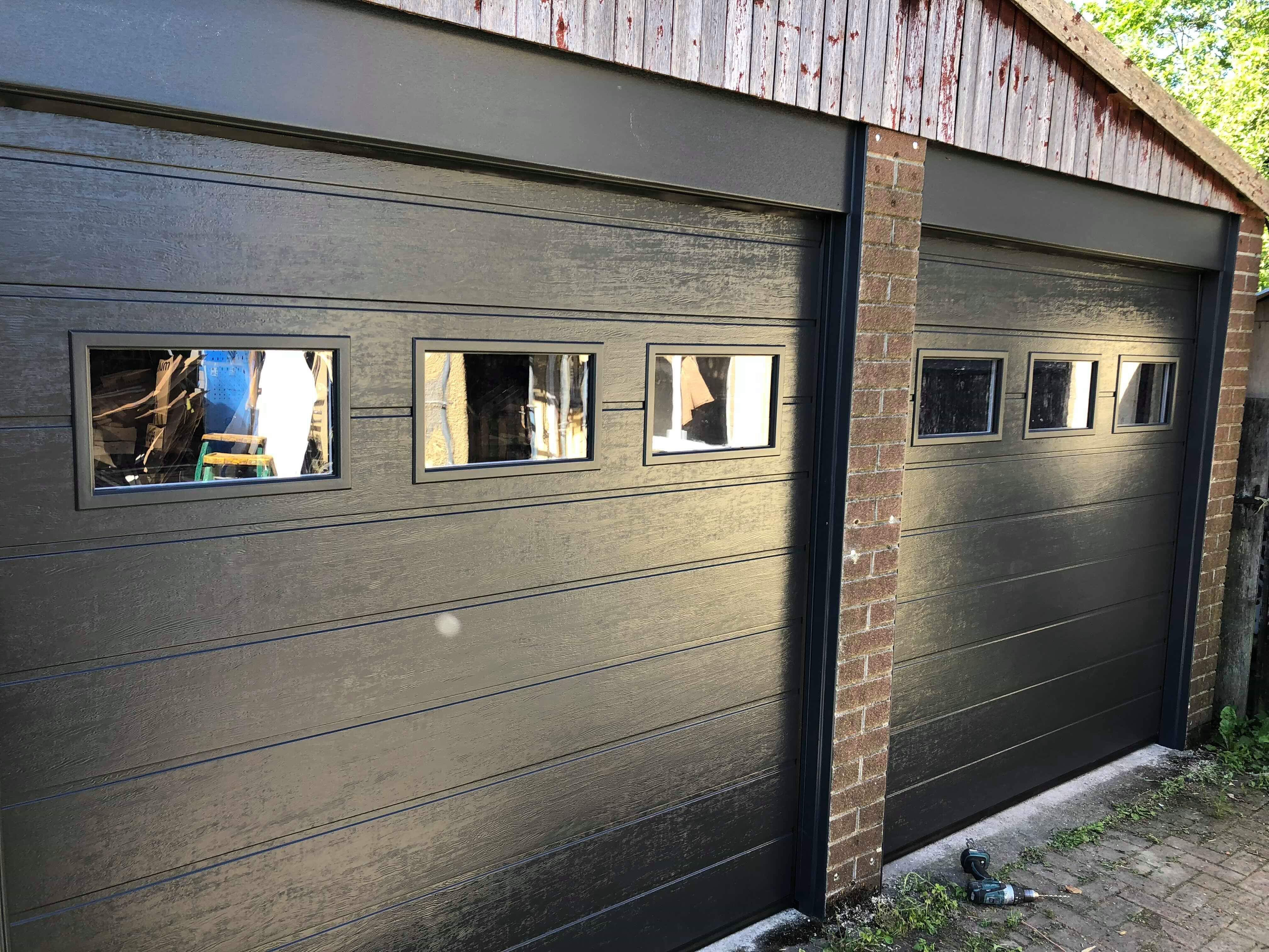 Two sectional garage doors in RAL colour with windows