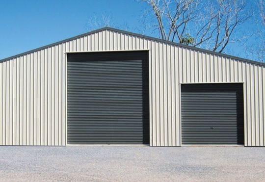 A large  and a small Gliderol light industrial doors fitted on an industrial unit.