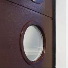 Alutech round window with colour matching frame