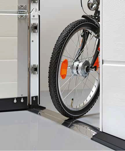 Wicket door with a trip-free threshold into your garage.