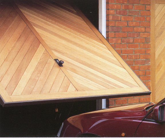 Hormann Chevron timber door with visible chassis powder coated in dark brown.