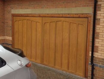 Cardale Tudor cedarwood automatic up and over garage door