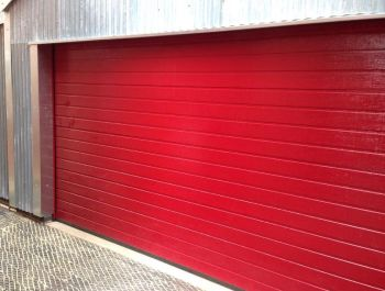 Insulated sectional garage door small rib in Red