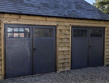 Two side hinged garage doors with windows in Anthracite Grey