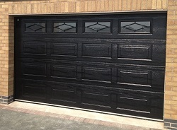 Picture of Carteck Georgian sectional garage door with windows installed by Ryan