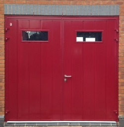 Picture of pair of Carteck insulated side-hinged garage doors installed by Ryan