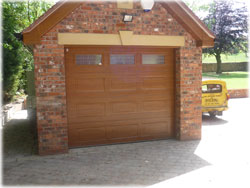 Picture of Georgian sectional garage door in Golden Oak