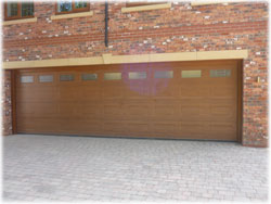Picture of Georgian sectional garage door on Golden Oak