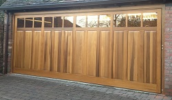 Glazed Woodrite timber up & over garage door fitted by Ryan