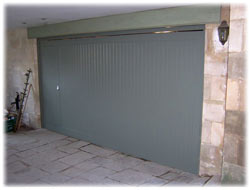 Cedar garage door with wicket viewed from outside