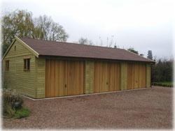 Woodrite side-hinged timber garage doors installed by Mark