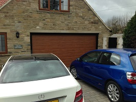 Picture of Carteck Georgian sectional garage door in Golden Oak