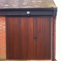 Picture of a pair of timber side-hinged garage doors