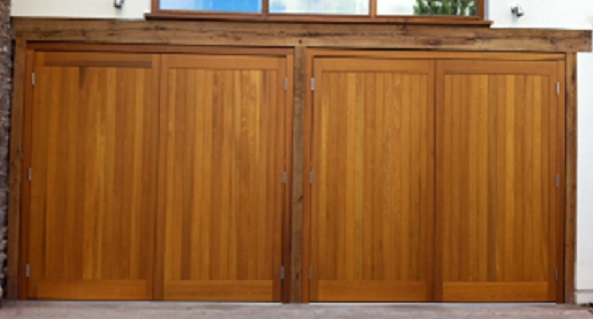 Picture of pairs of Cedar Door side hinged garage doors installed in Exeter