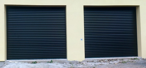 Picture of a pair of installed Aluroll insulated roller doors