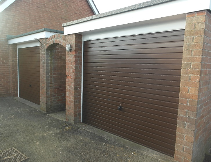 Pair of horizontally ribbed garage doors installed by Paul