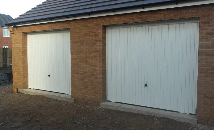 Picture of a pair of vertically garage doors fitted by Paul
