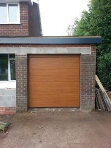 Hormann LPU insulated sectional garage door in Golden Oak