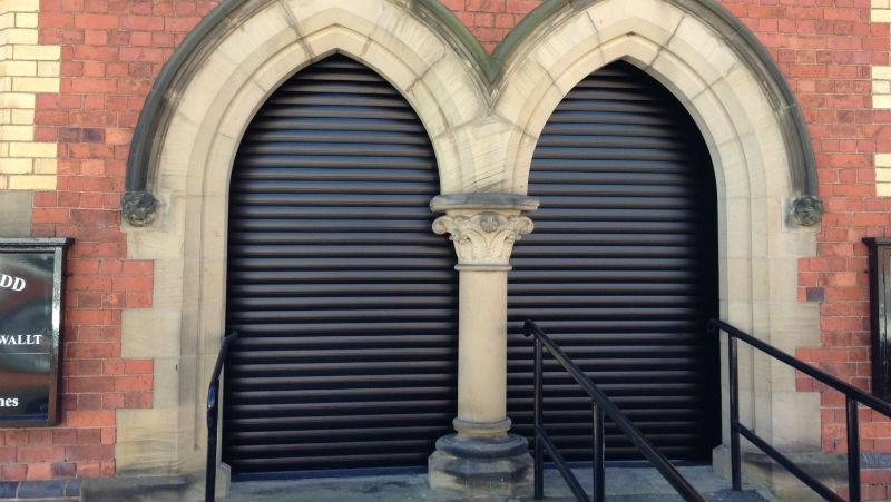 Aluroll Classic roller shutters in Black fitted in a Welsh Methodist Chapel